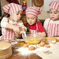Three little chefs enjoying in the kitchen